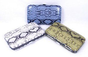 """6 Piece Snake or Lizard Print Case Manicure Pedicure Nail Kit for Home or Travel (Purple) by Howard's Jewelry. $12.99. Purple lizard or snake print case. Case measures 4 1/2"""" x 2 1/2"""" x 1/2"""". 6 Tools included - 2 (small & large) clippers, scissors, cuticle pusher, tweezers and file. What a fun gift idea for someone who likes to do their own manicure and pedicure. It's also perfect for purse, desk or travel in the event of a nail emergency! The outer case is done in a purple sna..."""
