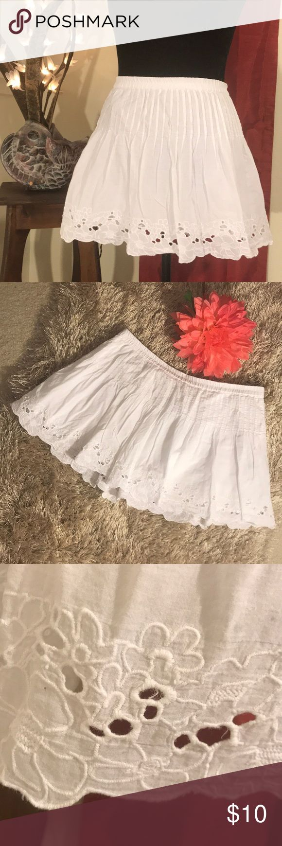 "Miniskirt Eyelet lace at the edge, rouched at the hip, this cute ultra mini is Snow White and cute as a button! Has a thin lining underneath. 100% Cotton, and in nice condition.  Measurements Approximate: 13.25"" - waist to hem 32"" - waist Aeropostale Skirts Mini"