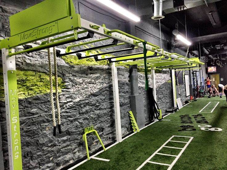 Custom functional training station wall bridge suspended over turf area leaving more training space. 30' Nova FTS wall bridge in custom colors. Wall post support bridge and offer different training options.