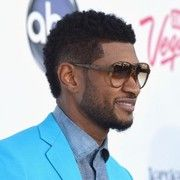 Usher's style is between a pompadour and a faux hawk.