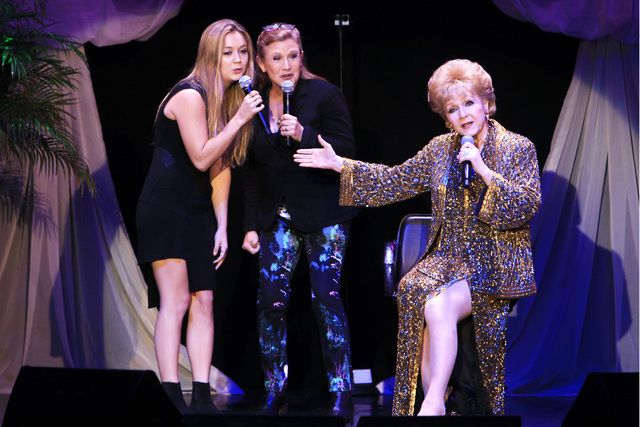 Debbie Reynolds was joined by daughter Carrie Fisher, son Todd Fisher and granddaughter Billie Lourd, far left, during Reynolds' show at the South Point on Saturday. It was the first time her son and daughter had been with her on stage. So sad - for me especially!