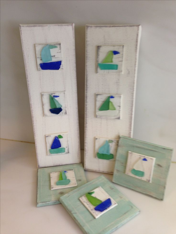 Seaglass sailboats on canvas. This is absolutely something I would snag up in a sec if I saw it for sale!! Cute!!