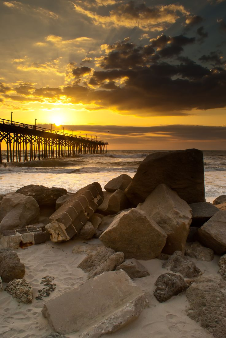 sunrise over a carolina beach pier