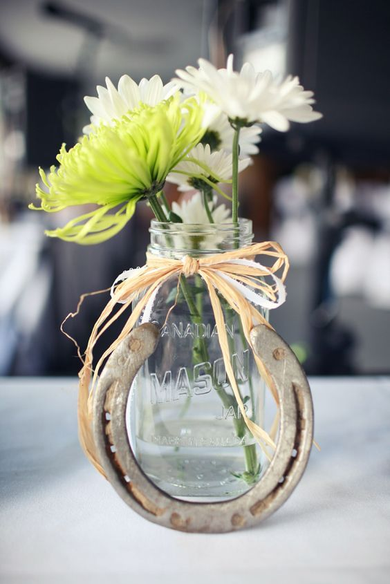 Mason jars and Horseshoes farm country wedding centerpiece / http://www.deerpearlflowers.com/rustic-farm-wedding-horseshoe-ideas/