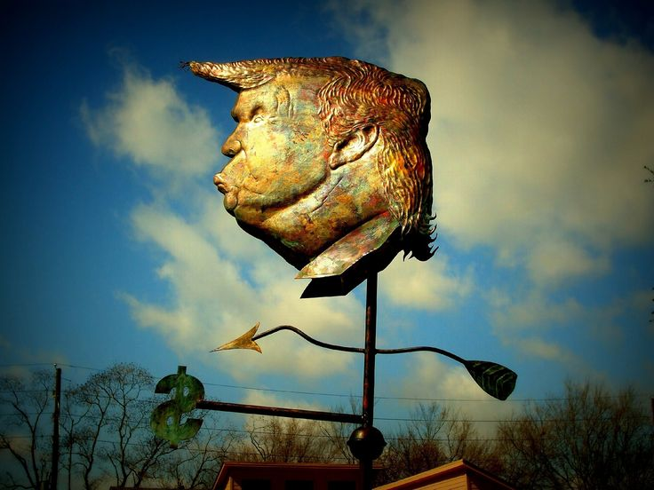 """Donald Trump Weathervane. """"I'll Be So Great for America It'll Make Your Head Spin"""" -- the Donald Trump weathervane. This original piece has been featured recently in the New York Daily News, the Houston Press, Britain's Mental Floss Magazine, The Daily Kos, and many others. Conceived as political satire, this weathervane is off-balance, spins maniacally, and always points to $. Sculpted in pure copper and silver with a natural patina. Overall dimensions are 26 inches in height X 22 inches…"""