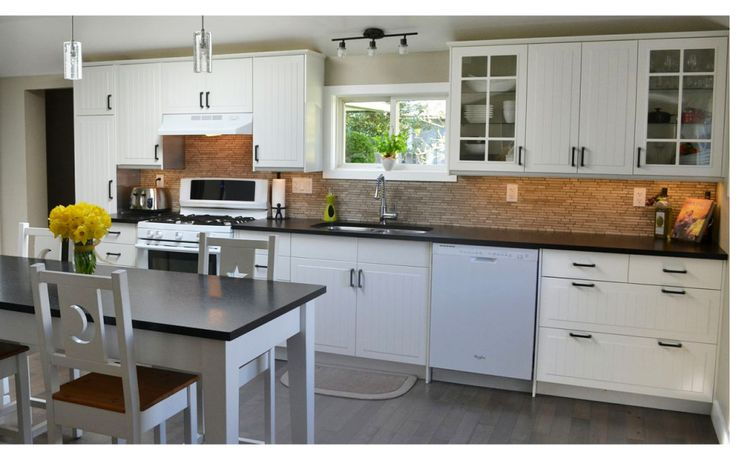 IKEA STAT doors paired with iron pulls from Lee Valley Tools in this Sidney kitchen.