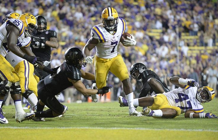 Advocate staff photo by TRAVIS SPRADLING --LSU running back Leonard Fournette (7) breaks the tackle of Texas A&M linebacker Richard Moore (7) to score a touchdown late in the second half of the LSU-Texas A&M football game in Baton Rouge, Saturday, Nov. 28, 2015. LSU won, 19-7, and Fournette broke the Tigers' single season rushing record.