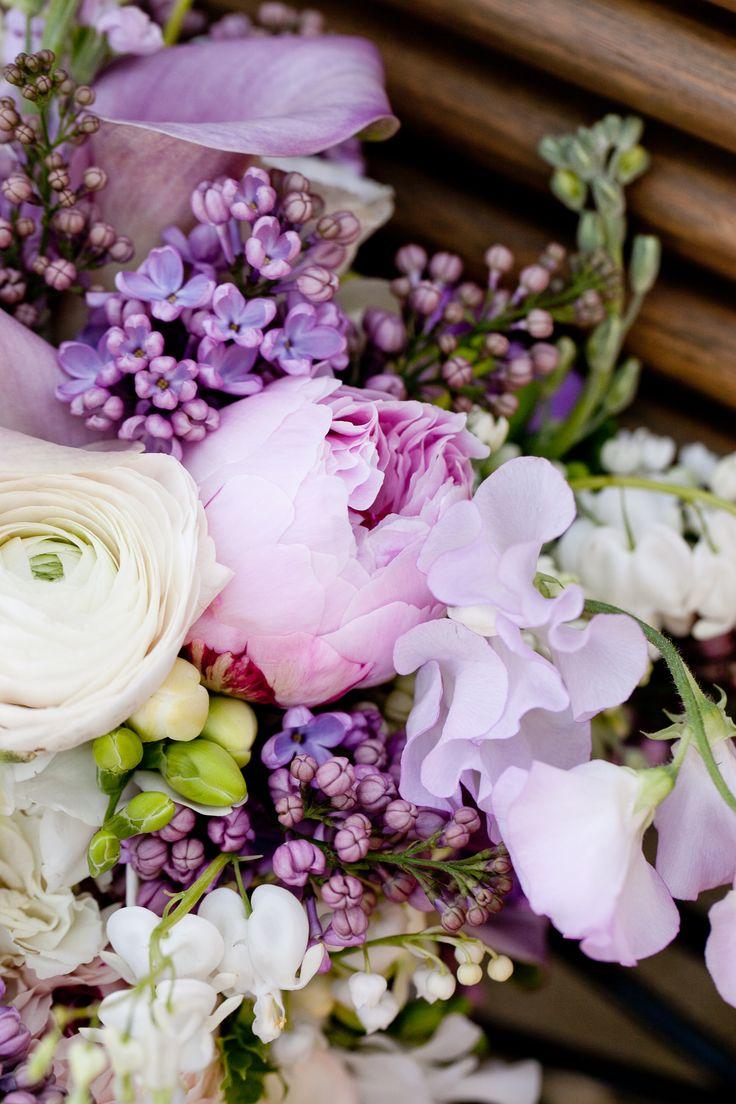 Rose, ranunculus, lilac, calla lily, bleeding heart, freesia, sweet pea. Beautiful.
