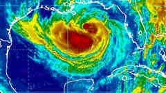Massive tropical storm Isaac aims at New Orleans, forecast to strengthen to category 2 hurricane