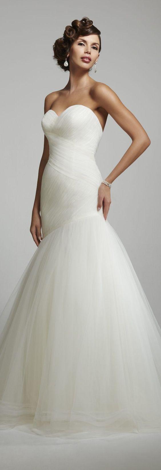 Sleek strapless mermaid style tulle skirt wedding dress; Featured Dress: Matthew Christopher