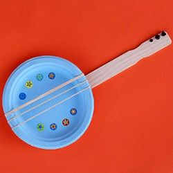 Kids get strumming! Paper Plate Banjo - colorful paper plates, paint stir stick and rubber bands for a super fun banjo.