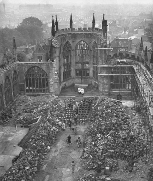 Despite being in near ruins thanks to nightly visits from the Luftwaffe, a rare services, like this one here, were still held in the shell of the Coventry Cathedral after its gutting by fire during the Blitz, 1944