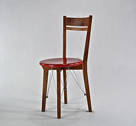 Irani chair design is our adaptation of the ubiquitous bent wood chairs found in the Irani cafes of Mumbai. The Irani cafes, famous for their tea & bun muska, were set-up & run by the Parsees & became integral part of the Mumbai culture, predominantly in the first & the middle part of the 20th century.  The Irani chair is made out of recycled teak with steel leg supports. The solid teak seat is scarlet red made out of stained lacquer.