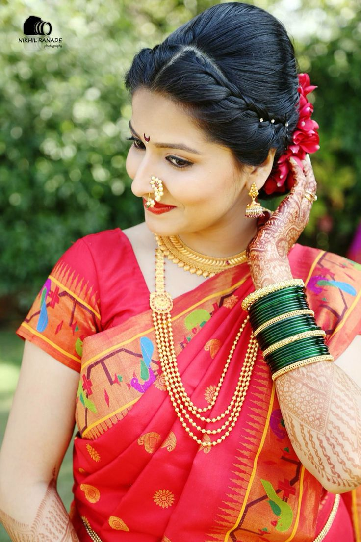 Maharashtrian bride wearing traditional saree and bridal jewellery. Bridal nath. Bridal braid hairstyle.