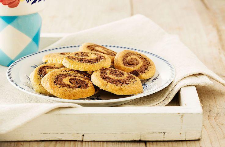 Zin in eens een ander koekjes recept? Bak dan deze swirlkoekjes met speculaas en koekjesdeeg!