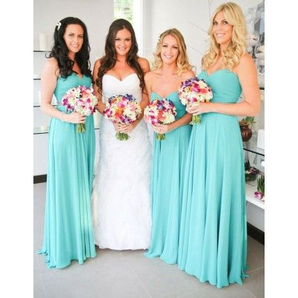 Emma's bridesmaids wore floor-length chiffon dresses in a bright shade of teal. A crystal belt defined their waists. Bridesmaid Dresses: Dion for Brides Ceremony and Reception: Katathani Phuket Beach Resort See more: A Brightly-Coloured Destination Wedding in Phuket, Thailand. Via The Knot