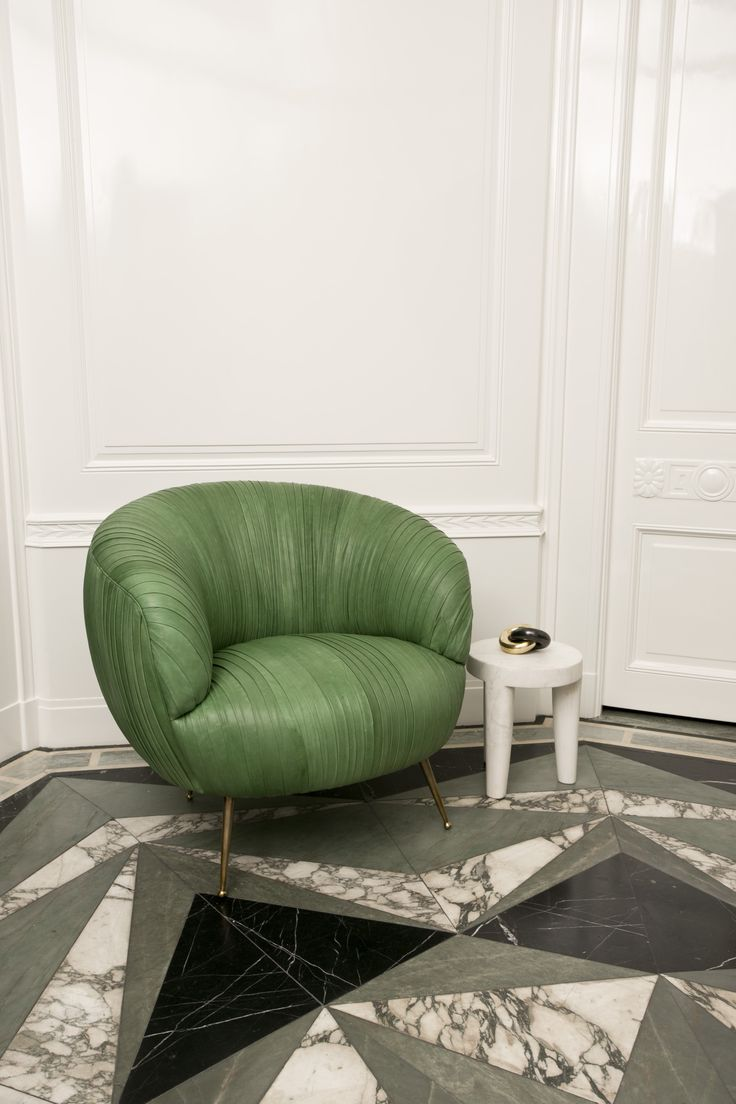 Souffle Chair in Kelly Green Ruched Leather. Floor un marble design by kelly wearstler #flooring