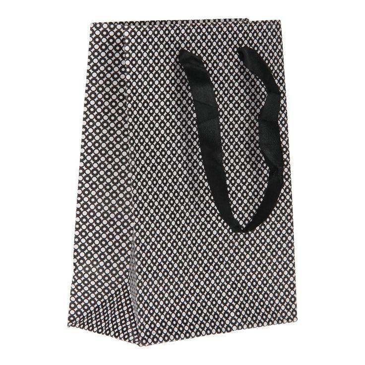 Je cadeau maakt nog meer indruk in dit kartonnen geschenktasje. In de set vind je 4 kleine geschenktasjes in een zwart/wit print met grijze details. Het zwarte lint als handvat maakt het cadeau helemaal af. Verschillende uitvoeringen door elkaar geleverd. Afmeting: 11 x 16 cm  - Geschenktas Zwart/Wit