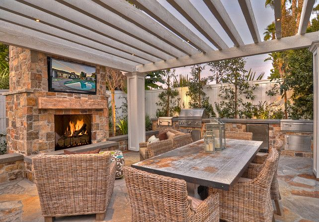 Pergola. Pergola with outdoor fireplace, outdoor furniture and TV. #pergola #OutdoorSpaces #PatioDecoratingIdeas