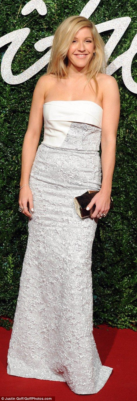 Looking good: The lovely lady accessorised with a box clutch and silver drop earrings...