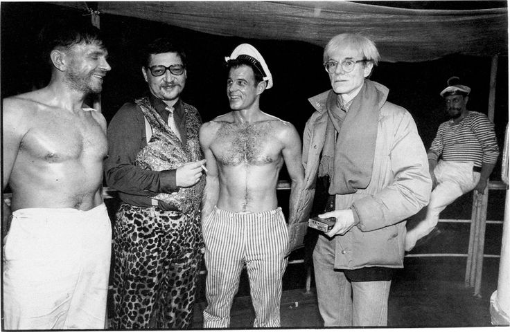 Rainer Werner Fassbinder, Brad Davis and Andy Warhol on the set of Querelle in West Berlin, March 1982.