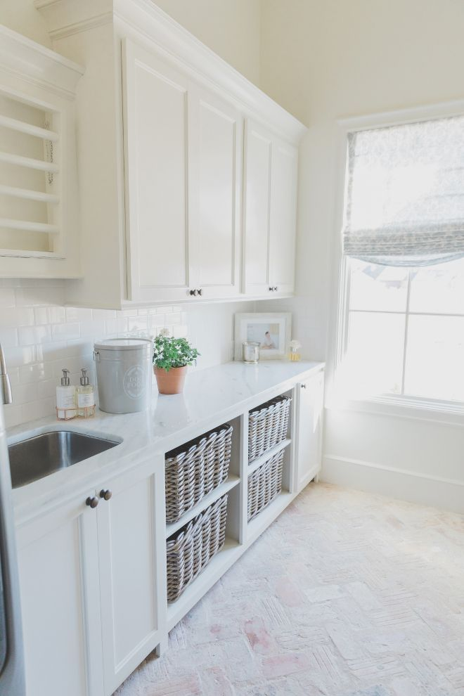 French Farmhouse Laundry Room With Herringbone Brick Flooring