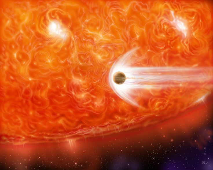 In this artist's conception, an expanding red giant prepares to swallow a too-close gas giant planet. In the solar system, when the sun becomes a bloated red giant, it will engulf Mercury and Venus, and may devour Earth.<br />