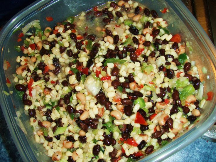 Texas Caviar: 2 cans black beans (Rinsed and Drained) 2 cans Black Eyed Peas (Rinsed and Drained) 2 cans Green Giant White Shoepeg Corn  (Drained) 1 c chopped green chiles (Rinsed and Drained) 1 lg red pepper (Diced) 1 lg sweet onion (Diced) Mix all ingredients together.   In a sauce pan combine: 1.5 c Apple Cider Vinegar & 1 c sugar. Heat until sugar is dissolved.  Add 1/2 cup of olive oil to pan and mix well.  Pour over vegetables and mix.  Serve cold or at room temp with Multi-grain…