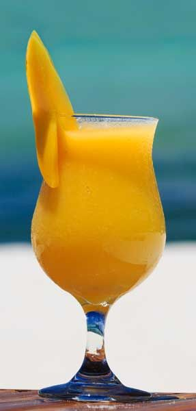 Mmm…Mango! 2 oz Svedka Mango Pineapple Vodka, 1 oz piña colada mix, 1 cup ice, 1 mango slice. Combine first three ingredients in a blender and blend until smooth. Pour into a Hurricane glass and garnish with a mango slice.