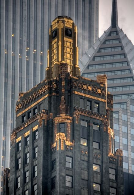 The Carbon & Carbide Building in Chicago. It is like a giant shiny gem amongst all the stone and glass Michigan Avenue. Completed in 1929, this building is made of light polished black granite, with the tower covered in a green terracotta.