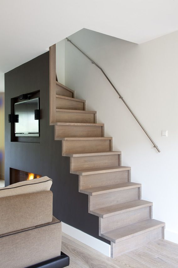 stairs open to room, rail on wall. also simple boxy design that might relate to new cabinetry?