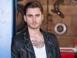 Charlie Clapham,  He's an actor. He plays freddie Roscoe in Hollyoaks.