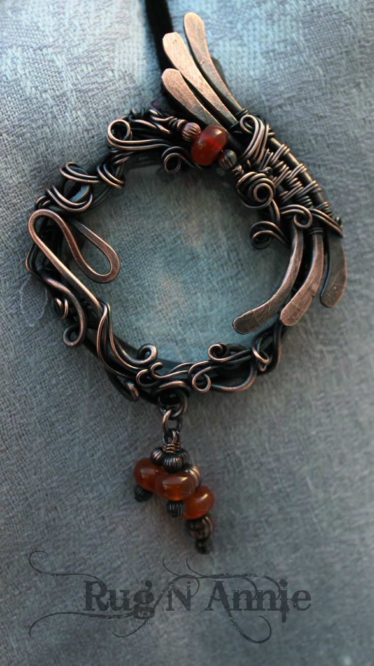 Copper wire, carnelian, and a magnifying glass....::)