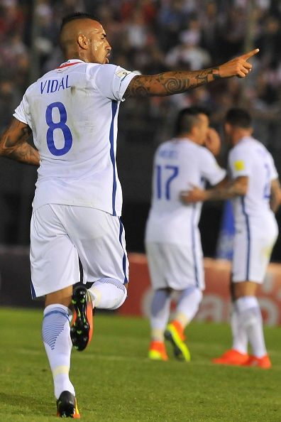 Arturo Vidal of Chile celebrates after scoring the first goal of his team during…