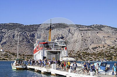 Harbour at  Symi Island in the Dodecanese Greece Europe. People  outbound from the passenger ship.