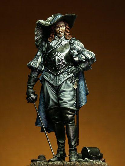 Moustache: Mechón largo de pelo, enredado por delante en el atuendo masculino del caballero del siglo XVII.