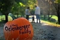 Fall Photo Sessions Ideas: A pumpkin with the family's name on it.  Copyright Amber S. Wallace Photography
