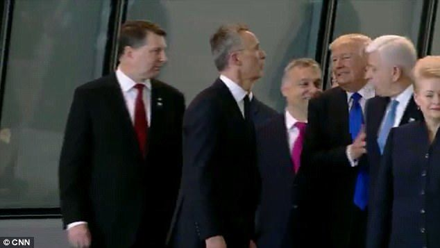 THAT'S MY POSITION!!! DONALD TRUMP SHOVES MONTENEGRO'S PRIME MINISTER ASIDE TO CLAIM HIS POSITION AT THE CENTER OF NATO GROUP PHOTO