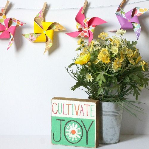 Turn bright, colorful paper into a fun pinwheel banner for summer following this easy tutorial!