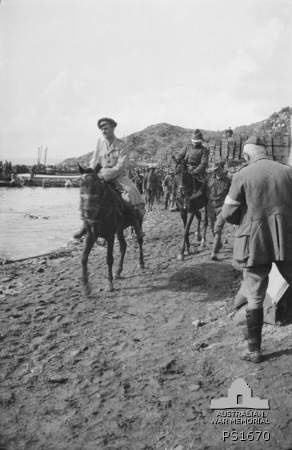 The Turkish Emissary for the Armistice riding along Anzac Cove blindfolded after the conclusion of the conference on 23 May 1915. Australian War Memorial photo