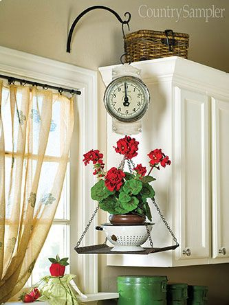 Relocate an outdoor hanging basket hook to the wall of the kitchen and use it to display everything from a decorative scale to a favorite copper pot to a bouquet of dried herbs. Just make sure you use the proper mounting hardware when installing the hook.