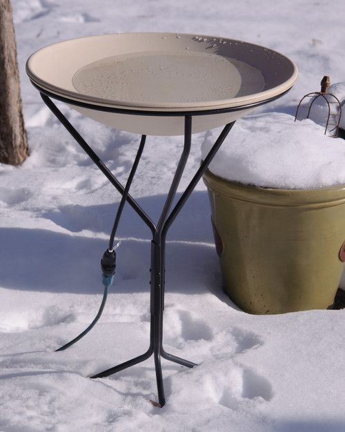 Here's a great heated bird bath concept that even uses snow for the water. Way to recycle! Using a simple plug, a bird bath can easily be heated enough to prevent the water inside the bird bath from freezing over. It's hard for most animals to find fresh water to drink during winter, so having a heated bird bath on your porch is a great idea.