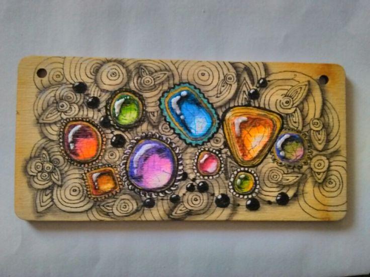 gem tangle on wood