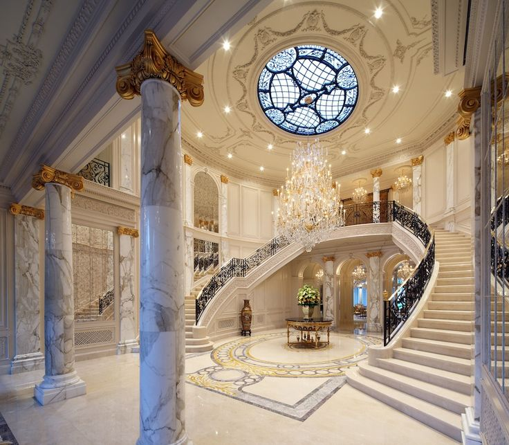 Beautiful Front Hall And Staircase: Ornate Hand-carved Imported Limestone Lines The Exterior