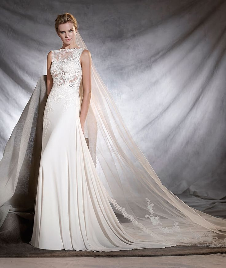 OSELETA - A-line gauze wedding dress. Find this dress at Janene's Bridal Boutique located in Alameda, Ca. Contact us at (510)217-8076 or email us info@janenesbridal.com for more information.