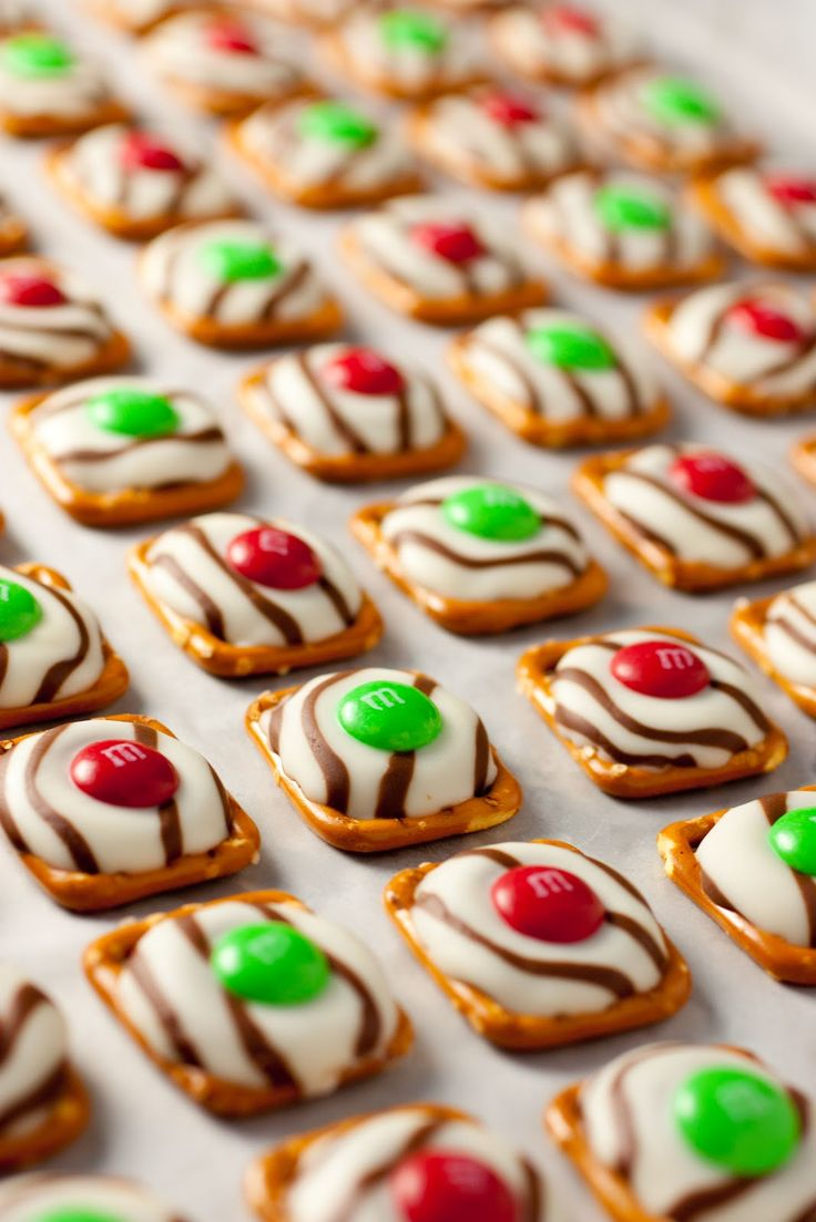 Pretzel M Hugs (Christmas style)   Yields 70 - Ingredients: 70 square pretzels (do NOT use butter snaps),   70 Hershey's Hugs chocolates (from nearly 1 full 12 oz package), unwrapped, 70 Milk Chocolate M's, use the red and green.