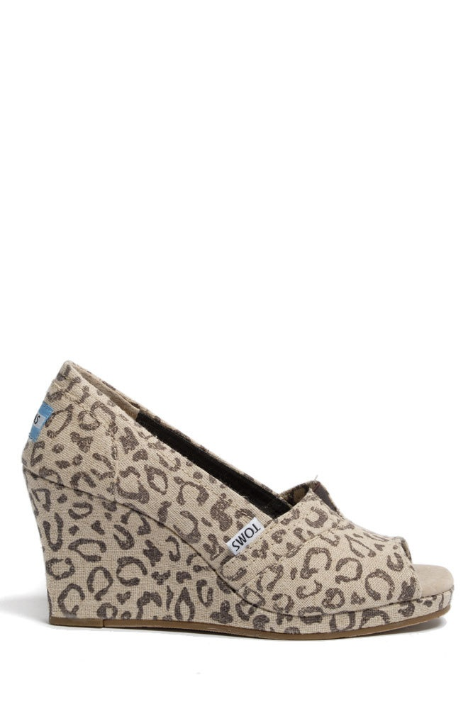 $69 TOMS does wedges? Who knew. TOMS Shoes Wedges in Snow Leopard Canvas