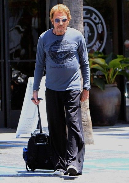 Johnny Hallyday Photos - French rocker Johnny Hallyday stops by the famous Gold's Gym for a workout in Venice, California on April 25, 2013. Johnny arrived and left in his custom blue hot rod. - Johnny Hallyday Heads to the Gym