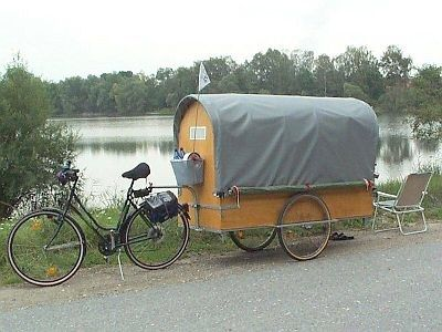German cyclist Günther Lorenz designed this DIY chuckwagon-style trailer to comfortably sleep one person