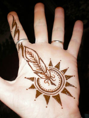 Henna Feathered sun.  This was painted for a swift and safe journey.